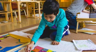 boy-doing-map-activity-living-montessori