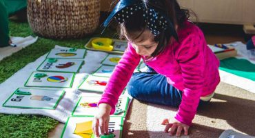 girl-doing-letter-activity-living-montessori