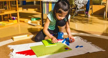 girl-doing-math-activity-living-montessori